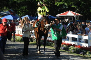 A Little Warm with his groom Marco en route to the track for a win in the Jim Dandy at Saratoga Racecourse.