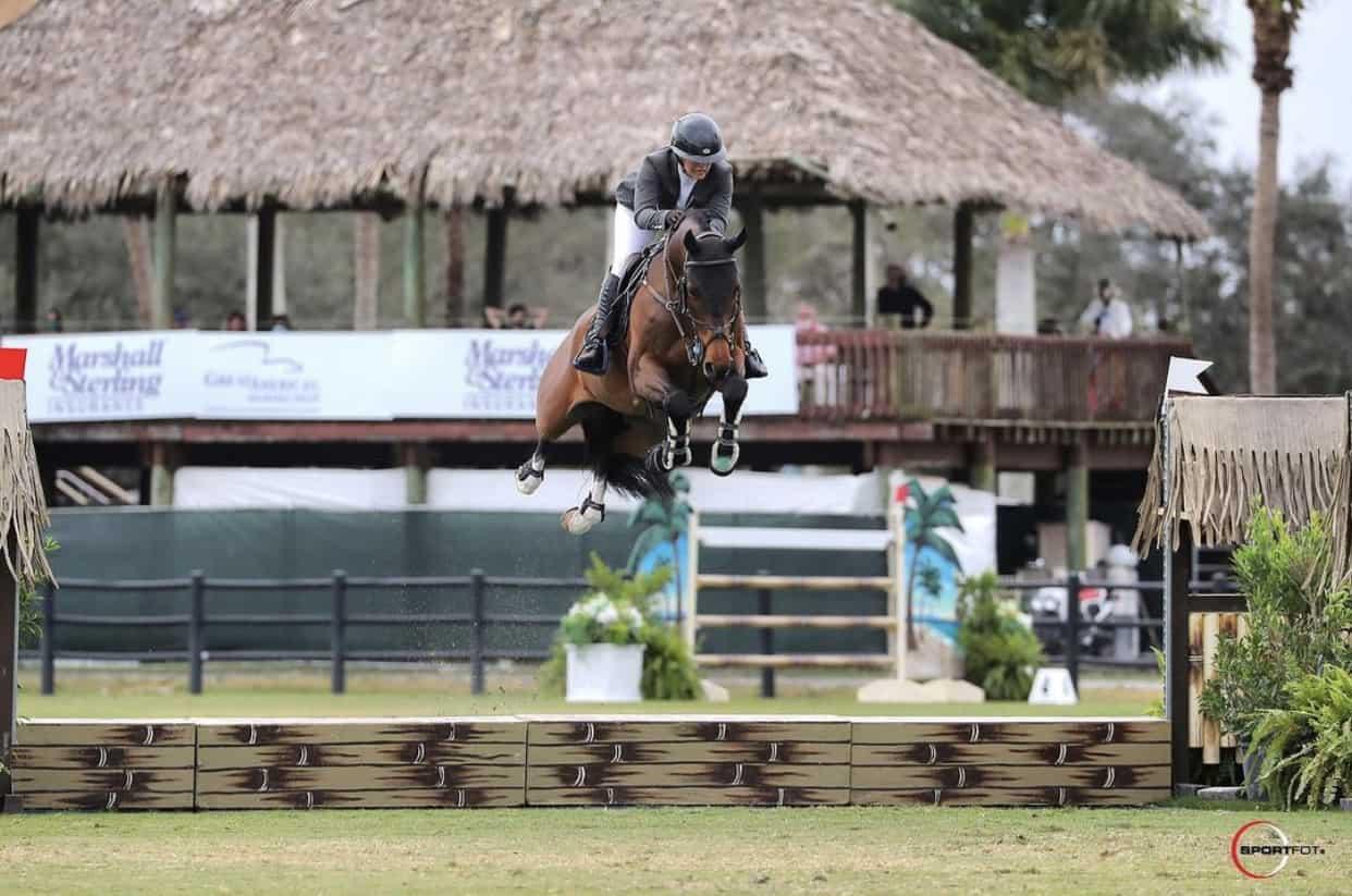 Ashlee Bond on horse jumping water